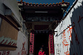 Worshippers walk out of the Tin Hau Temple in Nga Tsin Wai village which is to be demolished as part of a city reurbanisation plan in Wong Tai Sin...
