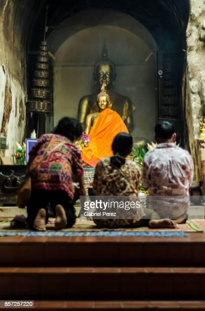 Worshipping a Buddha Statue in Chiang Mai