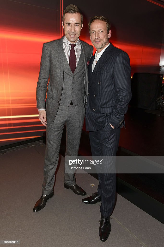 Wotan Wilke Moehring and Kai Pflaume attend the Audi City Berlin Opening on February 4 2014 in Berlin Germany