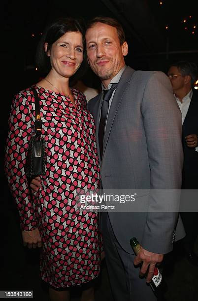 Wotan Wilke Moehring and partner Anna Theis attend the 'Mann Tut Was Mann Kann' Germany Premiere after show party on October 9 2012 in Berlin Germany