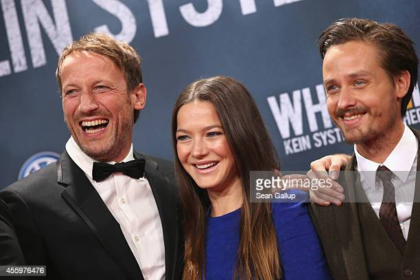 Wotan Wilke Moehring Hannah Herzsprung and Tom Schilling attend the premiere of the film 'Who am I' at Zoo Palast on September 23 2014 in Berlin...