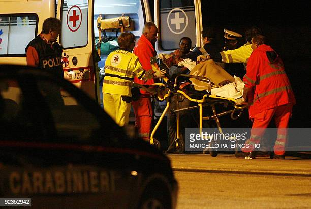A would be immigrant is carried to an ambulance at Pozzallo Harbour in southern Sicily on October 26 2009 Italian coastguards on Monday recovered one...