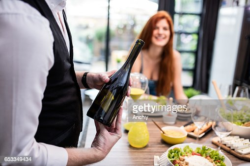 Would somebody like some wine? : Stockfoto