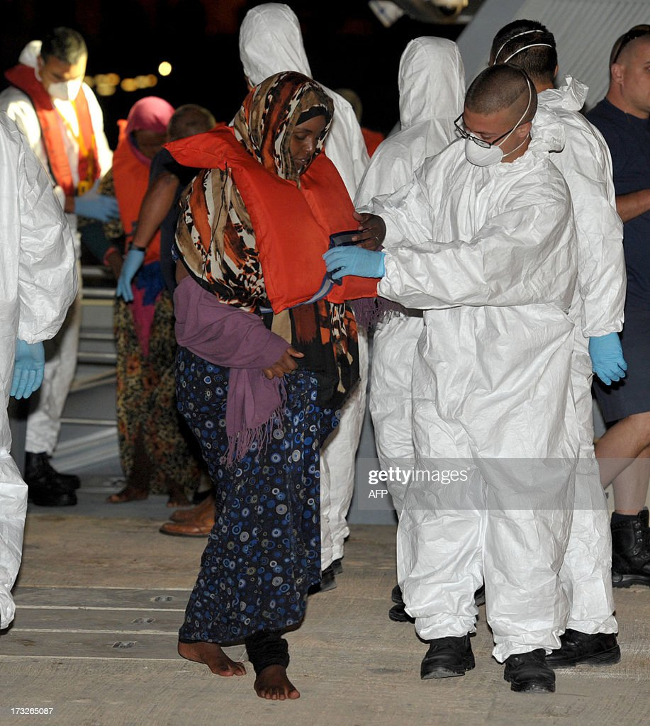 A would-be immigrant (L) disembarks from a Maltese patrol vessel at Hay Wharf in Valletta, after being rescued on July 10, 2013. The Maltese military rescued a boatload of 68 undocumented migrants, a day after the European Commission warned Maltese Prime Minister Joseph Muscat against sending possible asylum-seekers back to Libya. AFP PHOTO / MATTHEW MIRABELLI