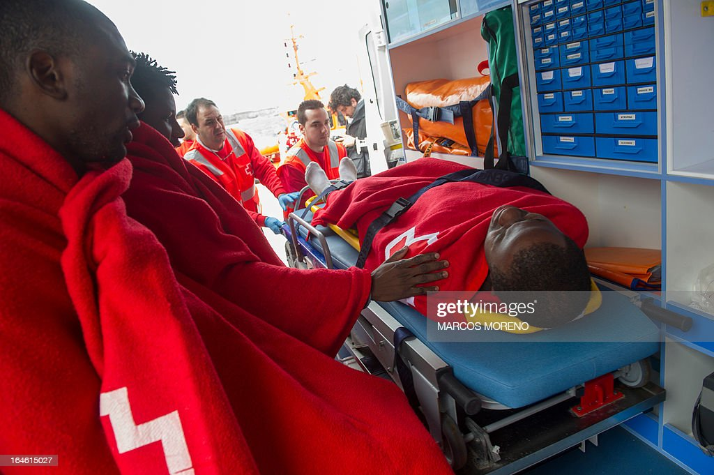 A would-be immigrant lays on a stretcher of Spanish emergency services after being rescued off the Spanish coast, nearTarifa, on March 25, 2013. Spanish emergency services rescued three rickety boats carrying 27 sub-Saharan would-be immigrants across the Strait of Gibraltar.