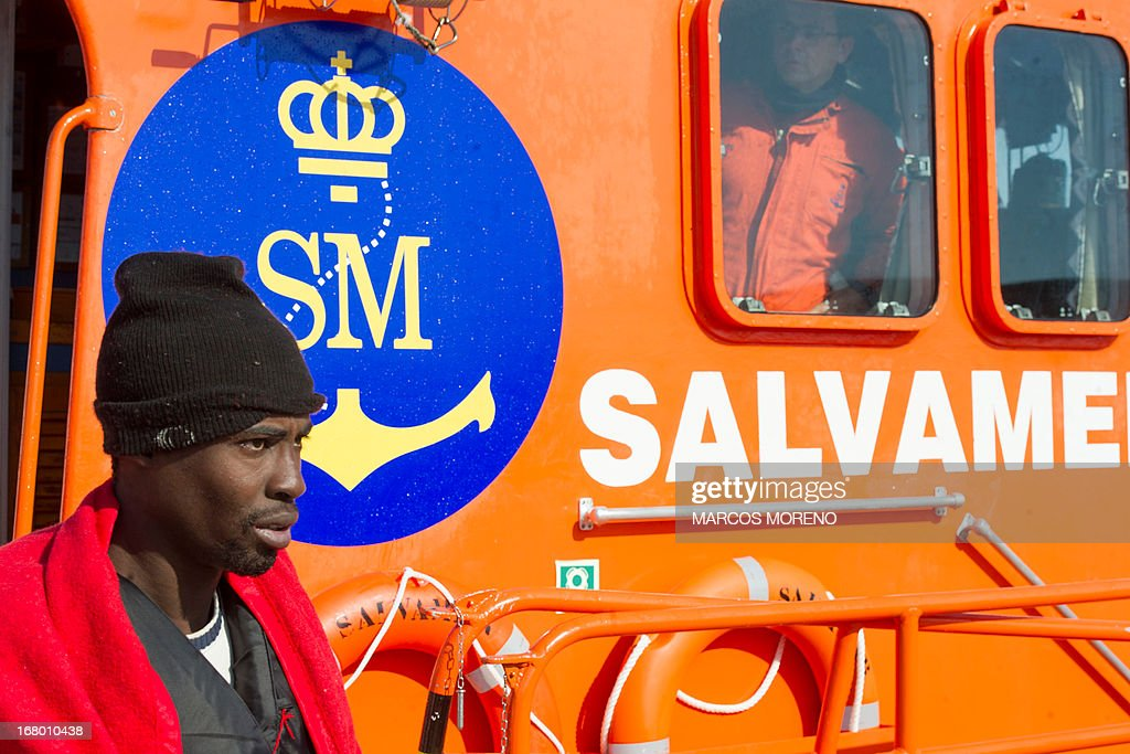 A would-be immigrant leaves a boat of the Spanish emergency services after being rescued off the Spanish coast and led to Tarifa, on May 4, 2013. Five boats carrying 66 sub-Saharan would-be immigrants were rescued, 4 by Morrocan emergency services and one by Spanish emergency services as they were crossing the Strait of Gibraltar.