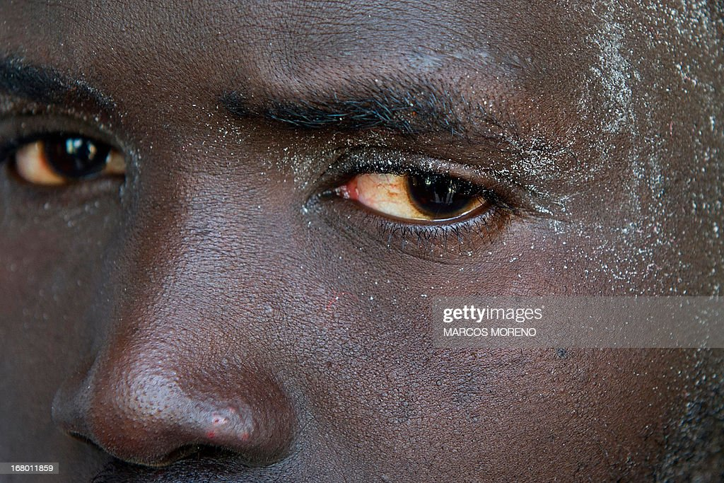 A would-be immigrant looks on after he left the boat of the Spanish emergency services which rescued him off the Spanish coast and led them to Tarifa, on May 4, 2013. Five boats carrying 66 sub-Saharan would-be immigrants were rescued, 4 by Morrocan emergency services and one by Spanish emergency services as they were crossing the Strait of Gibraltar.