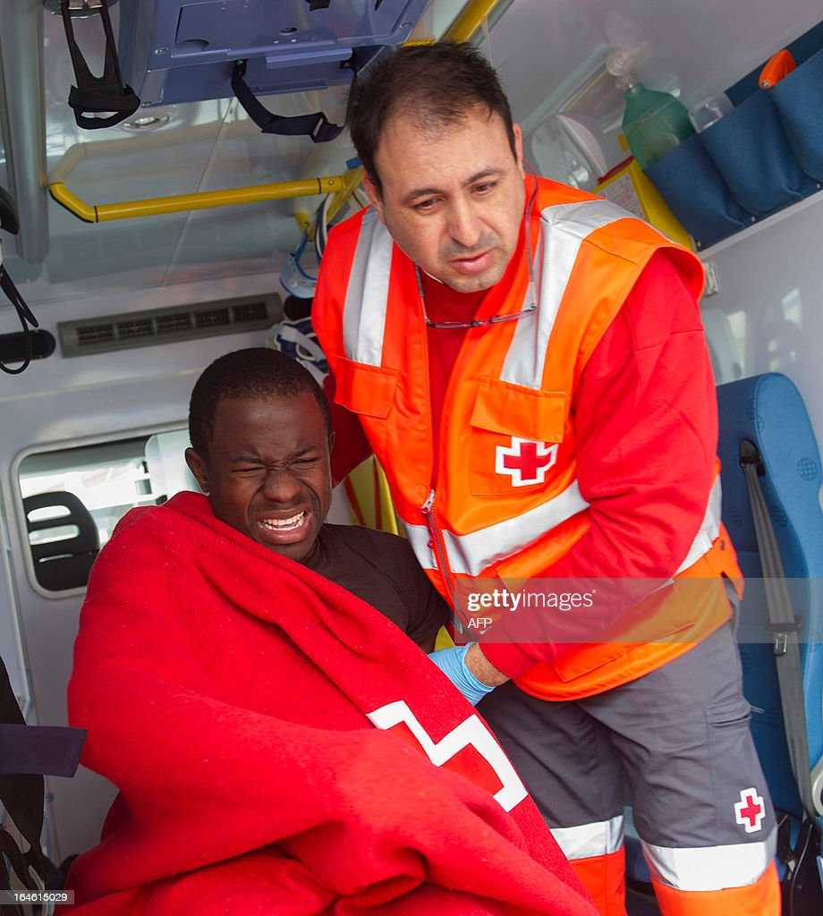 A would-be immigrant reacts on a stretcher of Spanish emergency services after being rescued off the Spanish coast, nearTarifa, on March 25, 2013. Spanish emergency services rescued three rickety boats carrying 27 sub-Saharan would-be immigrants across the Strait of Gibraltar.