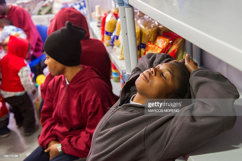 Would-be immigrants children relax at a Spanish Red Cross emergency services local in Tarifa, on December 28, 2012. Spanish rescuers intercepted today a boat carrying sub-Saharan would-be immigrants, 21 men, 7 women and 4 children accross the Strait of Gibraltar. Some of them suffered from hyporthermia.