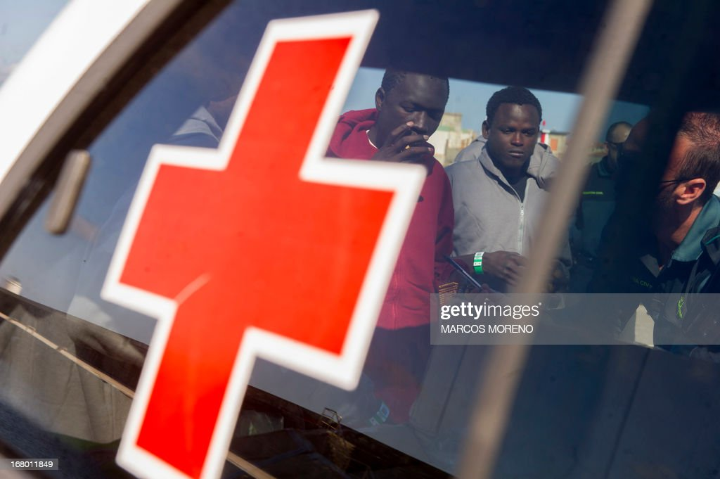 Would-be immigrants give informations to a Guardia Civil policeman, after they left the boat of the Spanish emergency services which rescued them off the Spanish coast and led them to Tarifa, on May 4, 2013. Five boats carrying 66 sub-Saharan would-be immigrants were rescued, 4 by Morrocan emergency services and one by Spanish emergency services as they were crossing the Strait of Gibraltar.