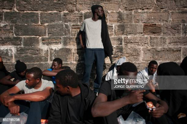 TOPSHOT Wouldbe immigrants rest after being rescued in the waters of the Strait of Gibraltar in the port of Tarifa on August 16 2017 Since 1am today...