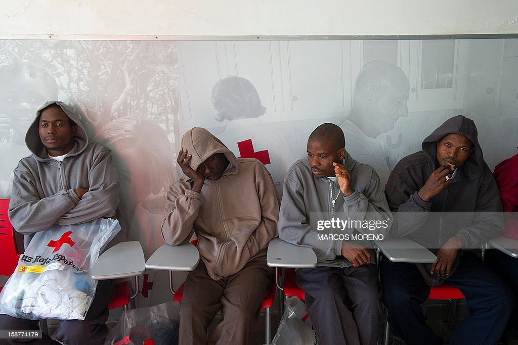Would-be immigrants rest at a Spanish Red Cross emergency services local in Tarifa, on December 28, 2012. Spanish rescuers intercepted today a boat carrying sub-Saharan would-be immigrants, 21 men, 7 women and 4 children accross the Strait of Gibraltar. Some of them suffered from hyporthermia.