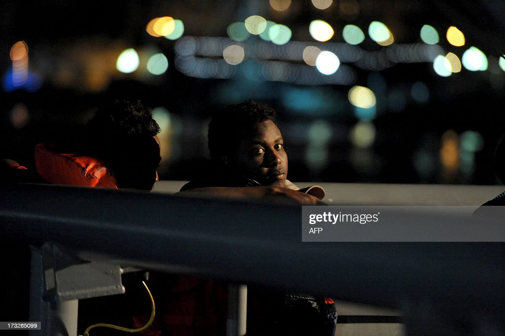 Would-be immigrants sit on a Maltese patrol vessel at Hay Wharf in Valletta, after being rescued on July 10, 2013. The Maltese military rescued a boatload of 68 undocumented migrants, a day after the European Commission warned Maltese Prime Minister Joseph Muscat against sending possible asylum-seekers back to Libya.
