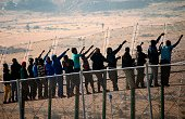 Wouldbe immigrants stand atop a boarder fence separating Morocco from the north African Spanish enclave of Melilla on May 1 following a morning...