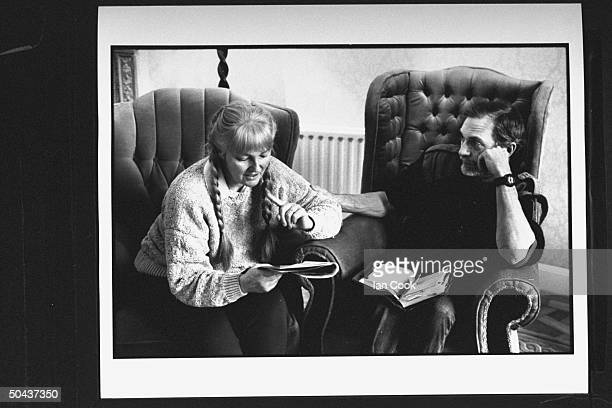 Wouldbe screenwriter Douglas Gresham son of Amer poet Joy Gresham executor of his stepdad CS Lewis's estate w open Bible on his lap as he chats w his...