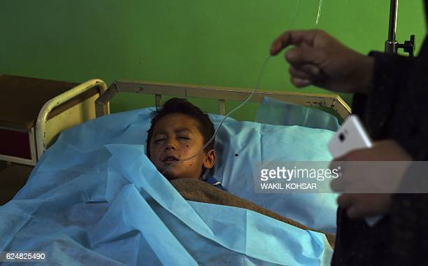 A wounded Afghan boy receives treatment at the Estiqlal Hospital after a massive suicide blast at a Shiite mosque in Kabul on November 212016 A...
