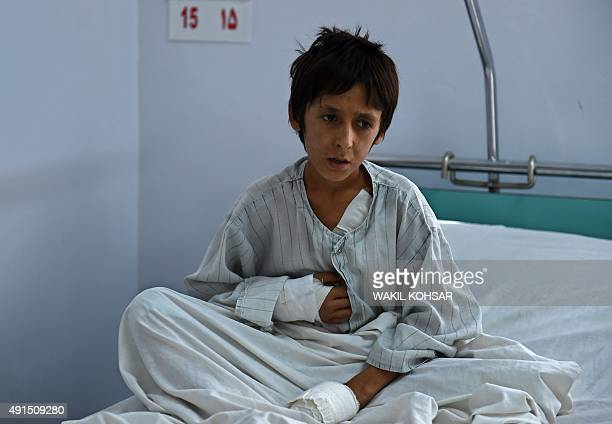 A wounded Afghan boy survivor of the US airstrikes on the MSF Hospital in Kunduz sits on his bed at the Italian aid organization Emergency's hospital...