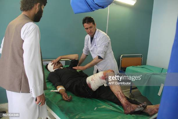 A wounded Afghan man receives treatment at a hospital after a suicide attack in Gardez capital of Paktia province on October 17 2017 The death toll...