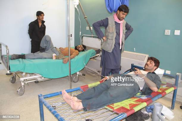 Wounded Afghan men receive treatment at a hospital after a suicide attack in Gardez capital of Paktia province on October 17 2017 The death toll in...
