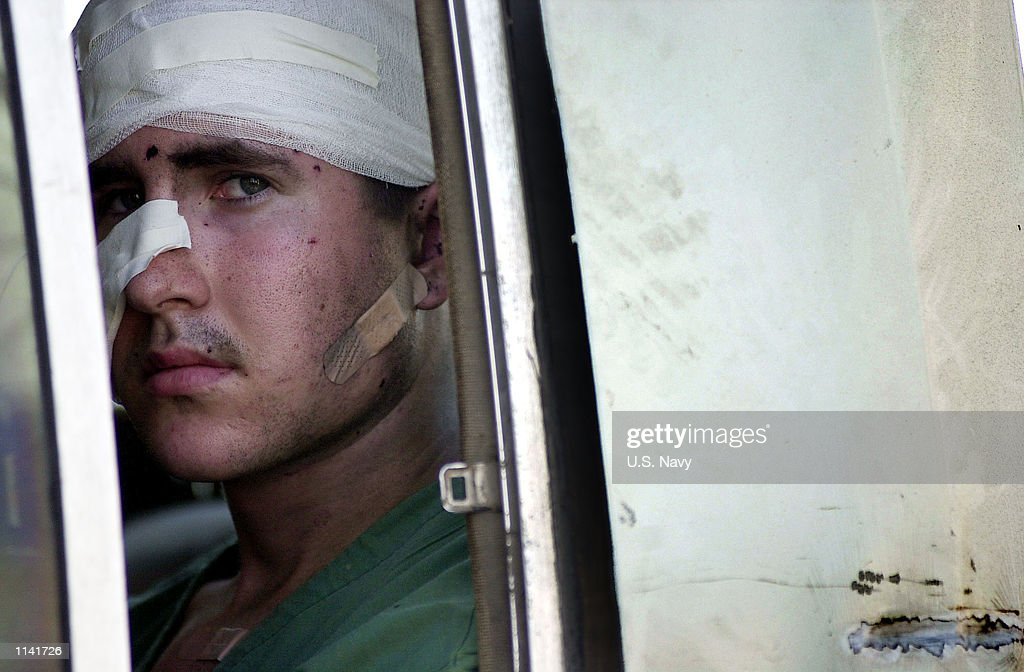 A wounded American sailor from the USS Cole departs a Yemeni hospital October 12, 2000 en route to additional medical treatment in Germany following the terrorist bombing attack on his ship in the port of Aden, Yemen.