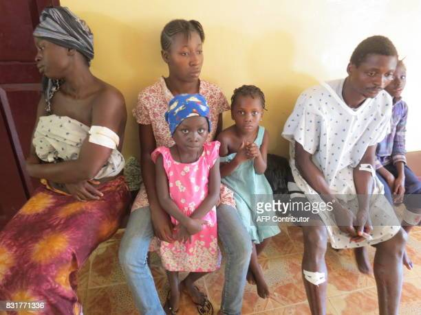 Wounded await treatment at a government hospital in Freetown on August 15 2017 after landslides struck the capital of the west African state of...