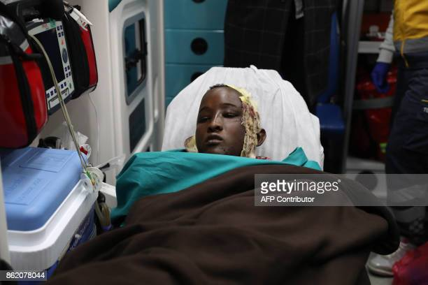TOPSHOT A wounded boy from the latest explosion in Mogadishu is carried on a stretcher to receive treatment in a Turkish hospital after a Turkish...