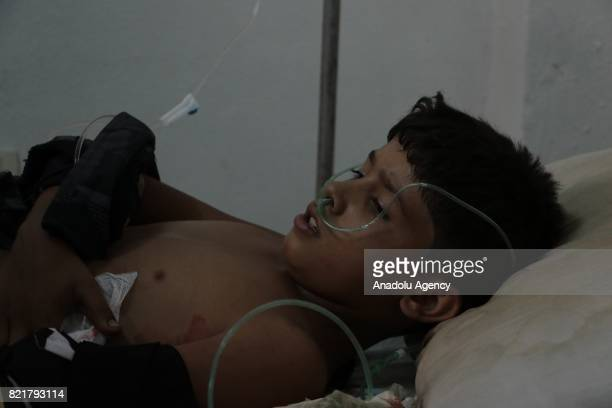 A wounded boy receives treatment at a Sahra hospital after Assad Regime's forces carried out airstrike over the deconflict zone Ayn Tarma town in the...