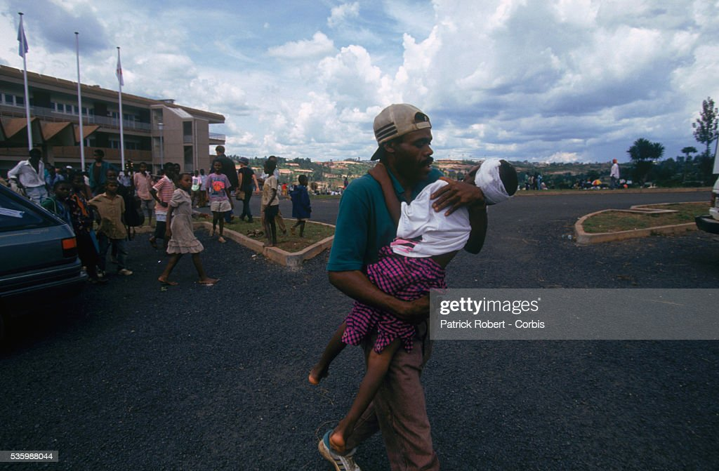 Wounded child being helped after the Amahoro Stadium was bombed by the army during the civil war in Rwanda.
