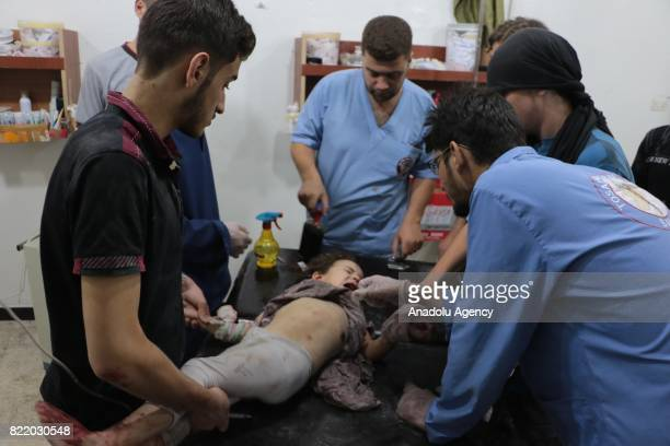 Wounded child receives treatment at a sahra hospital after Assad Regime's forces carried out airstrike over the deconflict zone Arbin town in the...