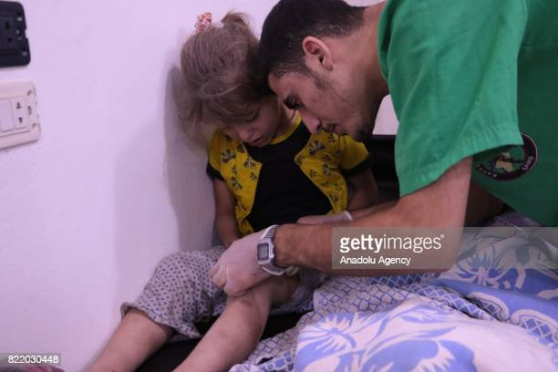 Wounded children receive treatment at a sahra hospital after Assad Regime's forces carried out airstrike over the deconflict zone Arbin town in the...