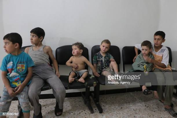Wounded children wait to receive treatment at a sahra hospital after Assad Regime's forces carried out airstrike over the deconflict zone Arbin town...