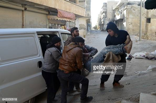 A wounded civilian is being hospitalized at the impact site after Assad Regime's airstrike over civilians in residential areas of Ariha town of Idlib...