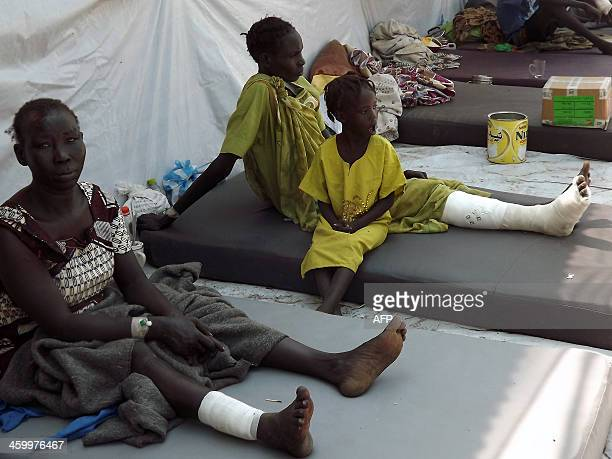 Wounded civilians rest after receiving treatment at the Malakal Hospital in the Upper Nile State of South Sudan on December 31 2013 following heavy...
