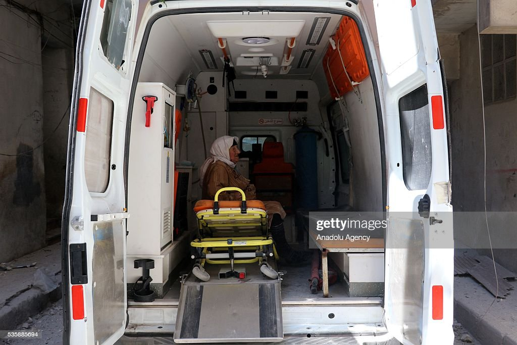 A wounded elderly woman waits inside an ambulance before she will be hospitalized after Assad forces hit residential areas with 'naval mines', thrown from helicopters in Kallese District of Aleppo, Syria on May 30, 2016.