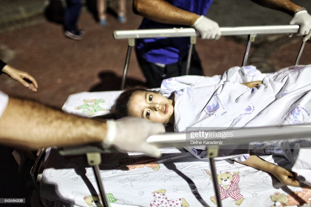 A wounded girl from the Ataturk Airport suicide bomb attack is carried to the Bakirkoy Sadi Konuk Hospital, in the early hours of June 29, 2016 in Istanbul, Turkey. Three suicide bombers opened fire before blowing themselves up at the entrance to the main international airport in Istanbul, killing at least 31 people and wounding 147 people according to Justice Minister Bekir Bozdag.