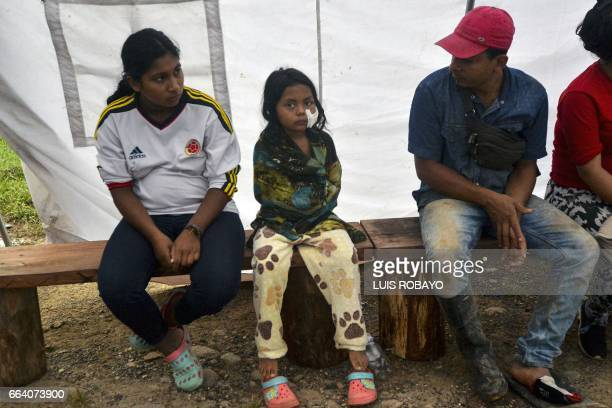 A wounded girl waits for medical attention at a shelter in Mocoa Putumayo department southern Colombia on April 3 2017 Residents of Mocoa were Monday...