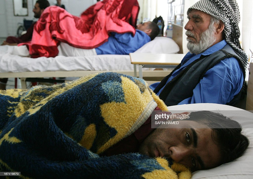 Wounded Iraqi men rest at a hospital in the northern Iraqi city of Arbil on April 25, 2013 after they were injured during violent clashes between security forces and Sunni Arab protesters in Hawijah. Iraqi Prime Minister Nuri al-Maliki warned of attempts to return the country to 'sectarian civil war,' as a wave of violence killed more than 140 people over three days. AFP PHOTO / SAFIN HAMED