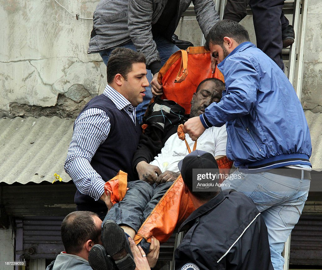 A wounded is being evacuated from the garment factory where fire broke out on November 7, 2013 in Turkey's Gaziantep province located in Southeastern Anatolia Region. Two killed and fourty-five wounded in the fire.