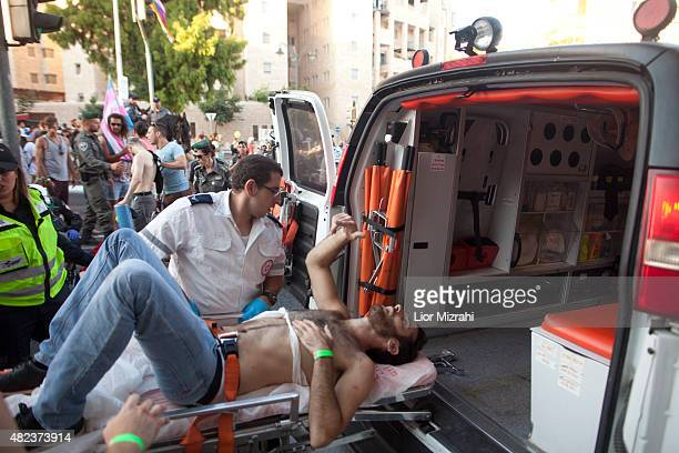 A wounded Israeli person receives treatment during the gay parade on July 30 2015 in Jerusalem Israel At least six people were stabbed at Jerusalem's...