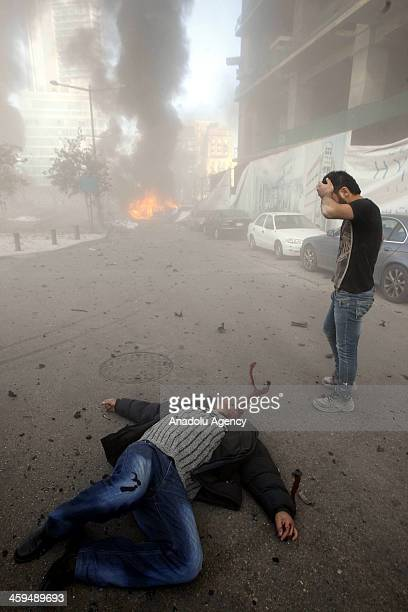 A wounded Lebanese man lies on the ground following a blast on December 27 2013 in Beirut Lebanon A powerful blast rocked Lebanese capital Beirut...