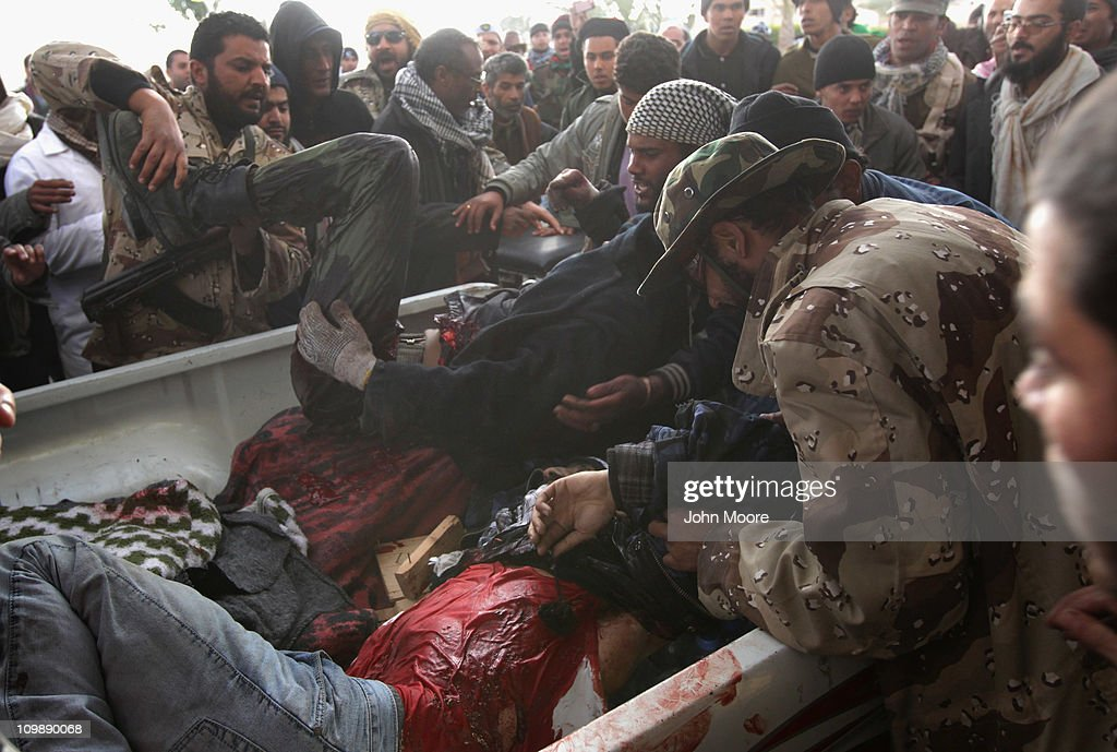 Wounded Libyan rebel soldiers are brought to a hospital after being injured fighting government troops on the frontline on March 9, 2011 in Ras Lanuf, Libya. The rebels battled government troops loyal to Libyan leader Muammar Gaddafi, pushing them back towards Ben Jawat.