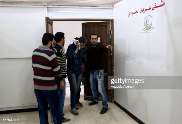 A wounded man arrives to receive treatment at a hospital after Assad regime's warplane carried out airstrikes over Arbin town of the Eastern Ghouta...