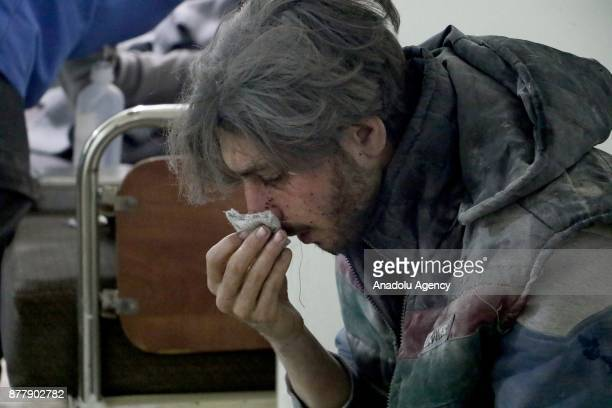 A wounded man receives treatment at a hospital after Assad regime's warplane carried out airstrikes over Arbin town of the Eastern Ghouta region in...