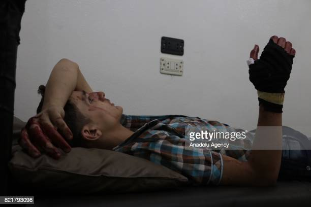A wounded man receives treatment at a Sahra hospital after Assad Regime's forces carried out airstrike over the deconflict zone Ayn Tarma town in the...