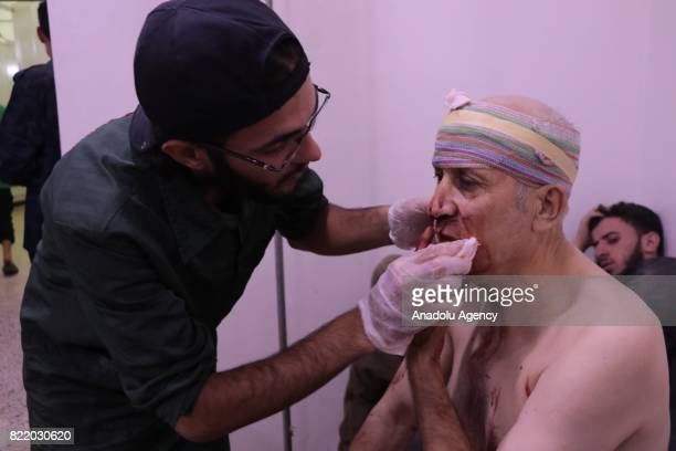 Wounded man receives treatment at a sahra hospital after Assad Regime's forces carried out airstrike over the deconflict zone Arbin town in the...