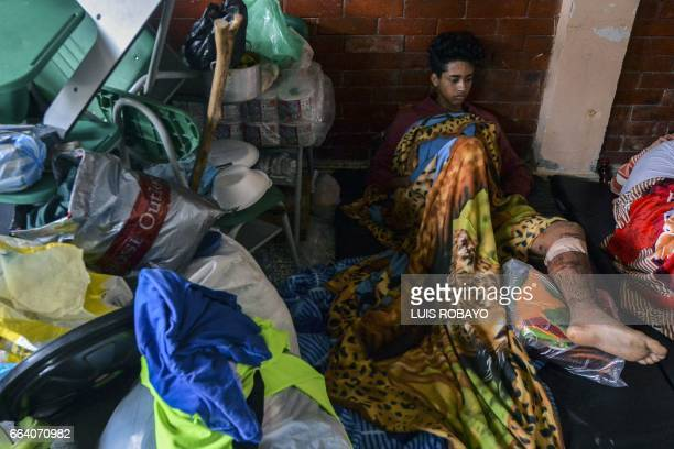 A wounded man rests at a shelter in Mocoa Putumayo department southern Colombia on April 3 2017 Residents of Mocoa were Monday desperately searching...
