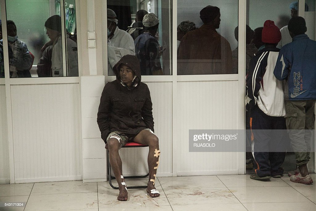 A wounded man sits at the University Hospital of Antananarivo (HJRA) to receive first aid after a bomb blast around 7.30 pm local time at Mahamasina Stadium during Malagasy Independence Day causing 84 wounded and 2 dead on June 26, 2016. At least two people were killed and some 70 wounded in a grenade blast at a stadium in Madagascar's capital today during celebrations marking the country's independence day, the gendarmerie said. / AFP / RIJASOLO