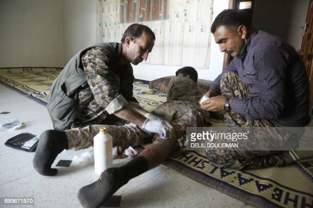 CORRECTION A wounded member of the Syrian Democratic Forces made up of an alliance of Kurdish and Arab fighters receives treatment after being...