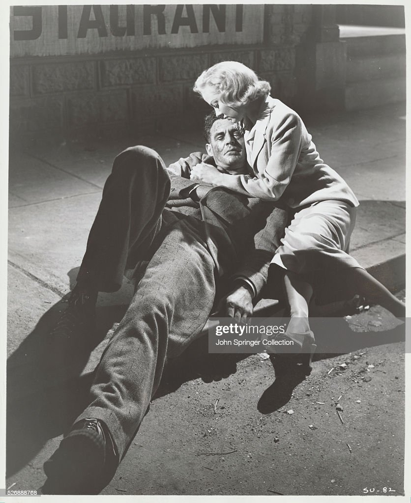 Wounded on the street Stoker is comforted by Julie in the 1949 film The SetUp Robert Ryan and Audrey Totter starred