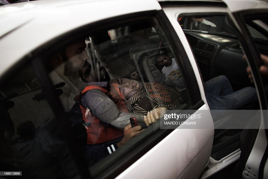 A wounded Palestinian boy arrives at al-Shifa hospital in Gaza City on November 16, 2012. A rocket fired by militants in the Gaza Strip hit a West Bank settlement bloc just south of Jerusalem, Israeli police said, with the army saying it had called no injuries or damages.
